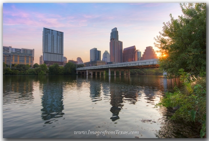 The Austin skyline is visible from along the Hike and Bike trail at Zilker Park.